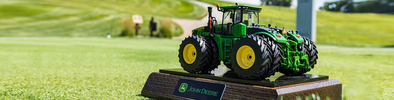 Miniature tractor on plaque marks the tee at the John Deere Classic Golf Tournament.