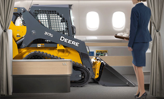 Artist's concept of a 317G Compact Track Loader enjoying an upgraded flight experience in first class with a flight attendant offering a hot towel