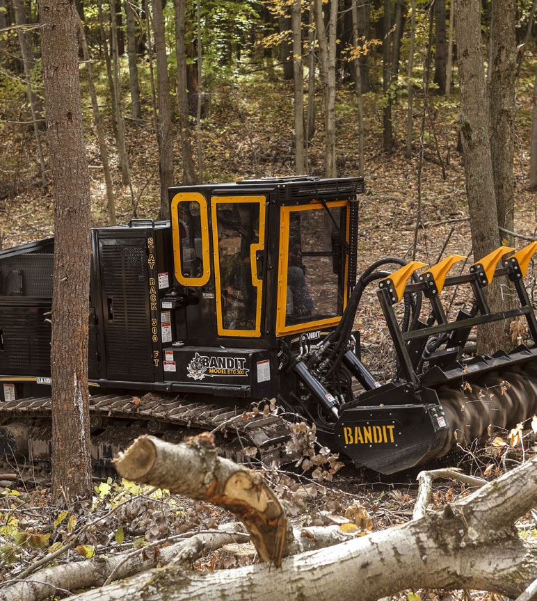 Bandit wood-processing mower in forest