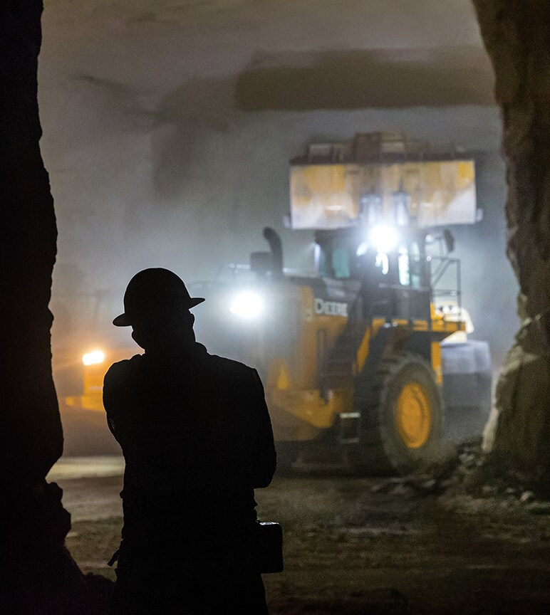 Silhouette of man in front of underground construction equipment