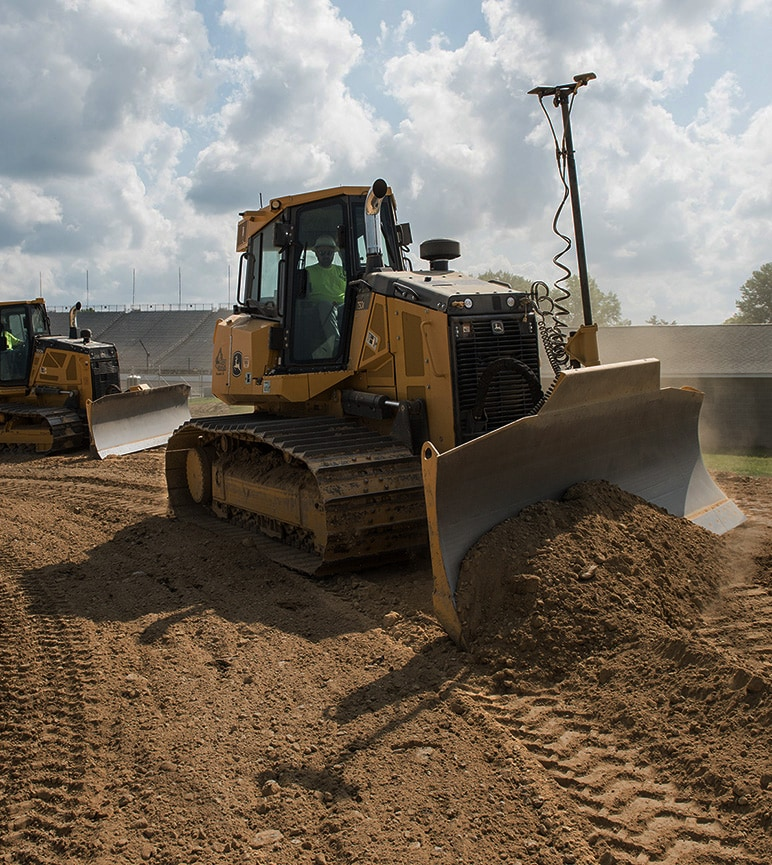Crawler dozer pushing dirt at a worksite.