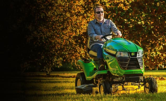 Man mowing lawn on an X350 lawn tractor