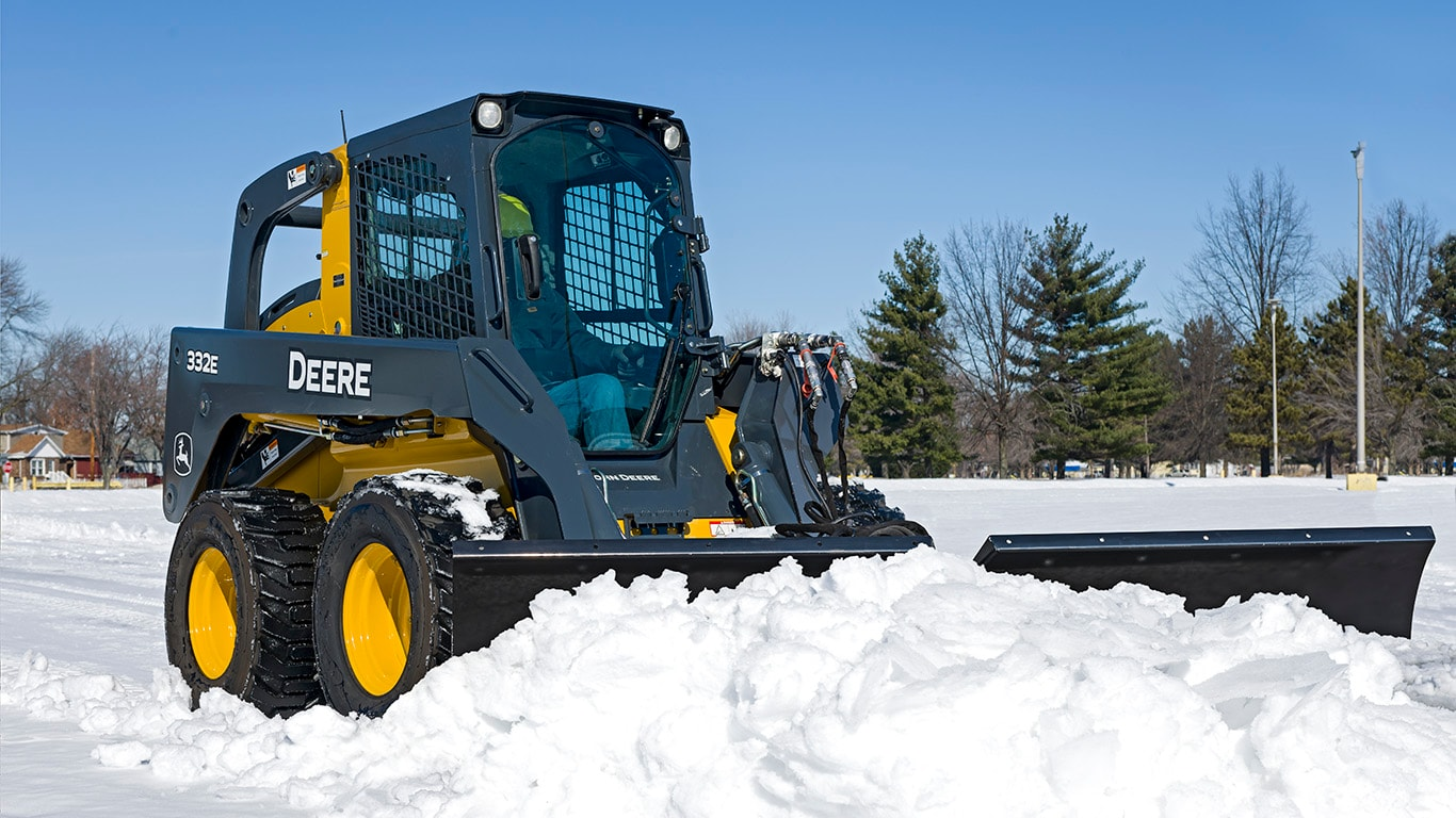 332E Skid Steer with Snow V-Blade attachment.