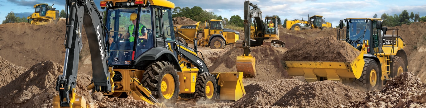 John Deere dozer, haul truck, backhoe, excavator, wheel loader and motor grader on a jobsite