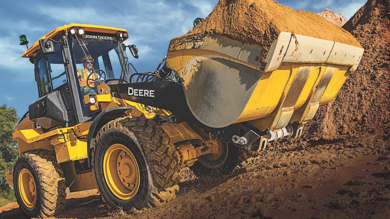 444L mid-size wheel loader, bucket full of dirt on an earthmoving jobsite