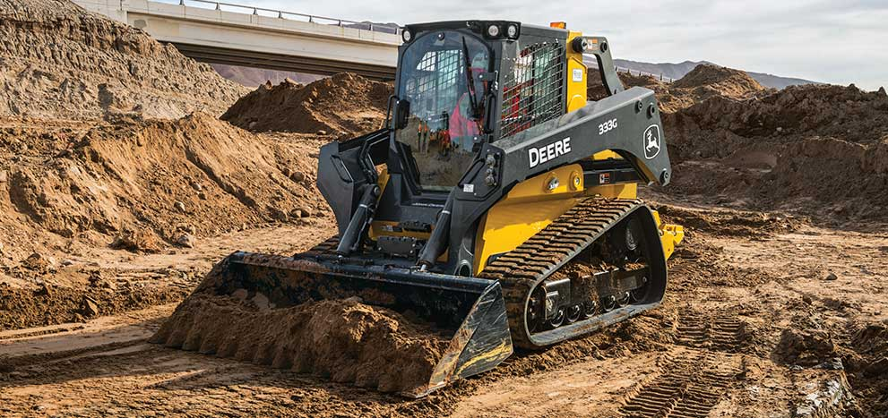 333G compact track loader moving dirt
