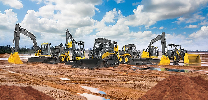 Lineup of construction and compact construction equipment at a jobsite