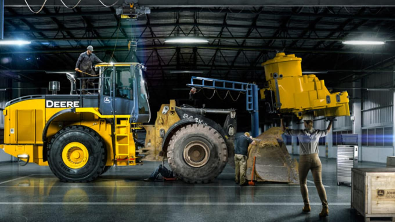 image of technicians rebuilding a wheel loader