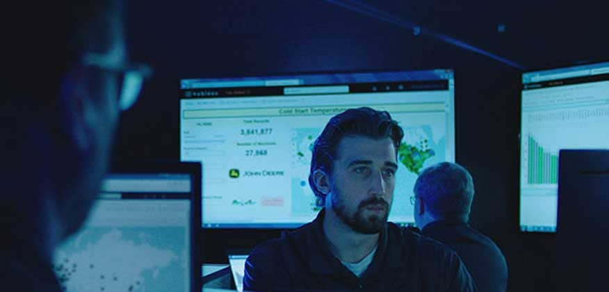 Personnel view data on large screens and computer monitors