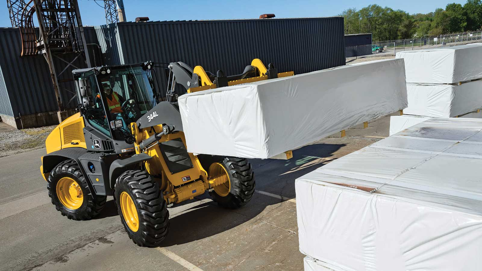 344L Compact Wheel Loader moving pallets