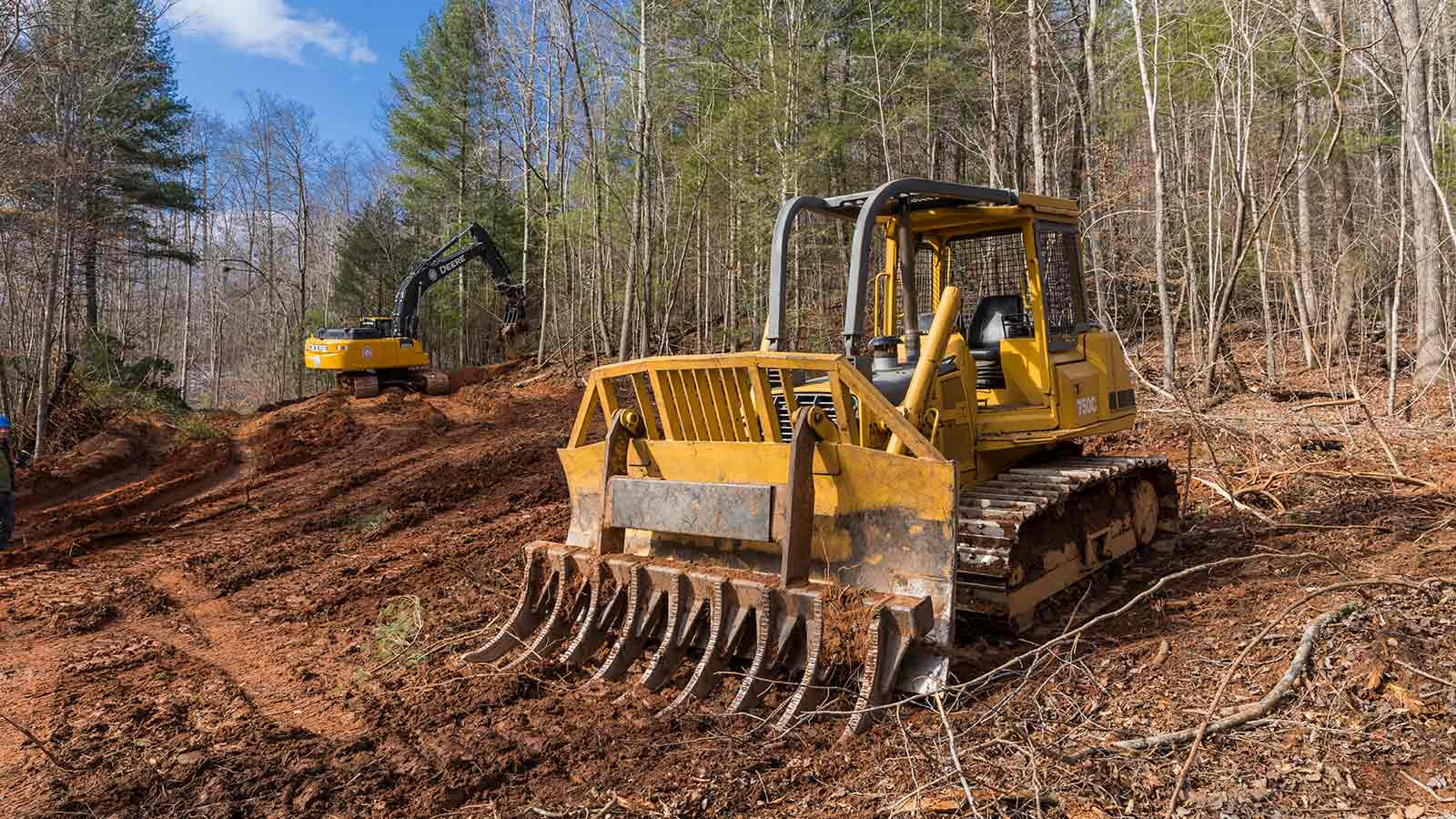 Tim Ferris' most-admired machine, a John Deere 750C Dozer, is shown on a construction site.