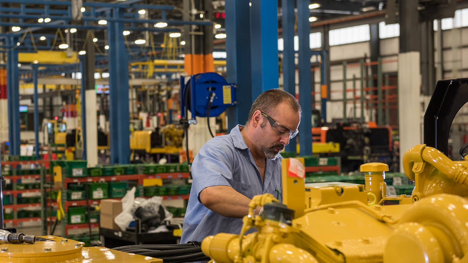 Sammy Flynt, an Assembly Lead Technician, at work in the Deere-Hitachi factory