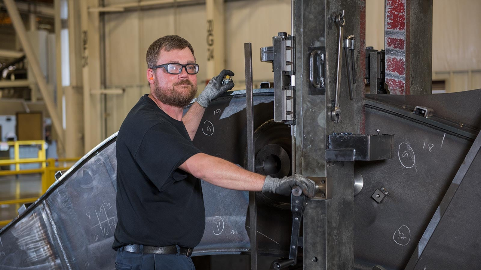 Joe Walker, a machining technician, shown working in the Deere-Hitachi factory