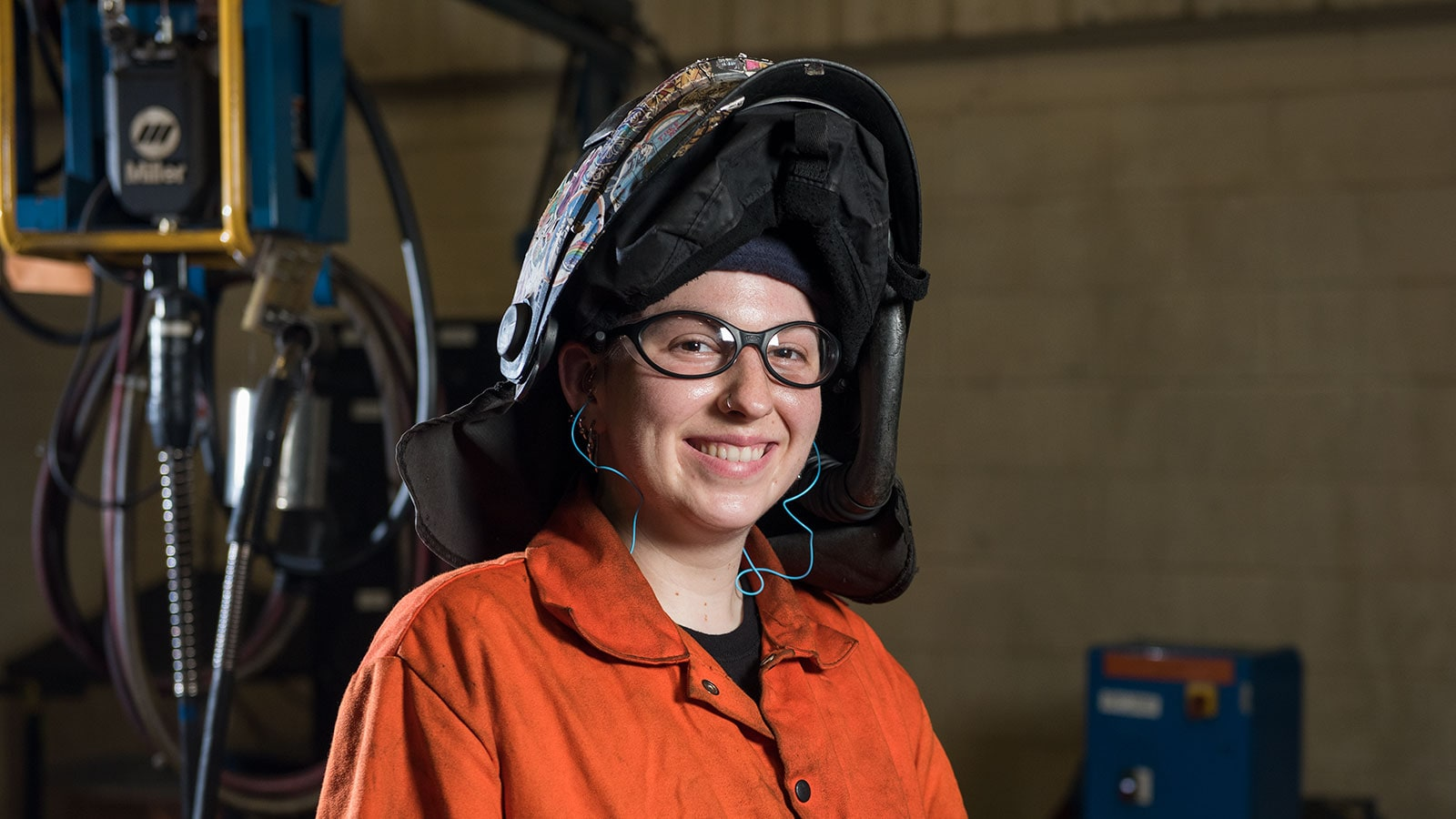Sam McCart, a welder, shown working in the Deere-Hitachi factory