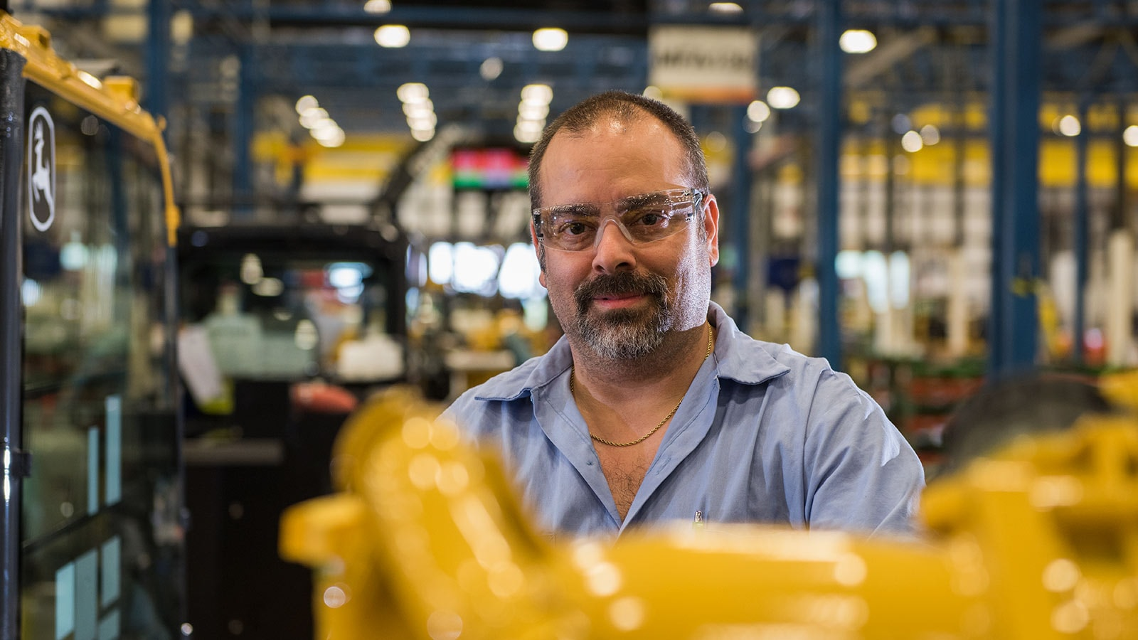 Sammy Flynt, Assembly Lead Technician, shown working in the Deere-Hitachi factory