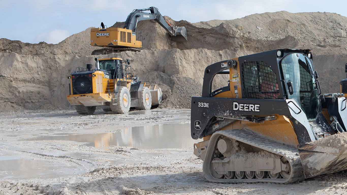 A 870G LC Excavator, a 944K Wheel Loader, and a 333E CTL work in a quarry in Florida