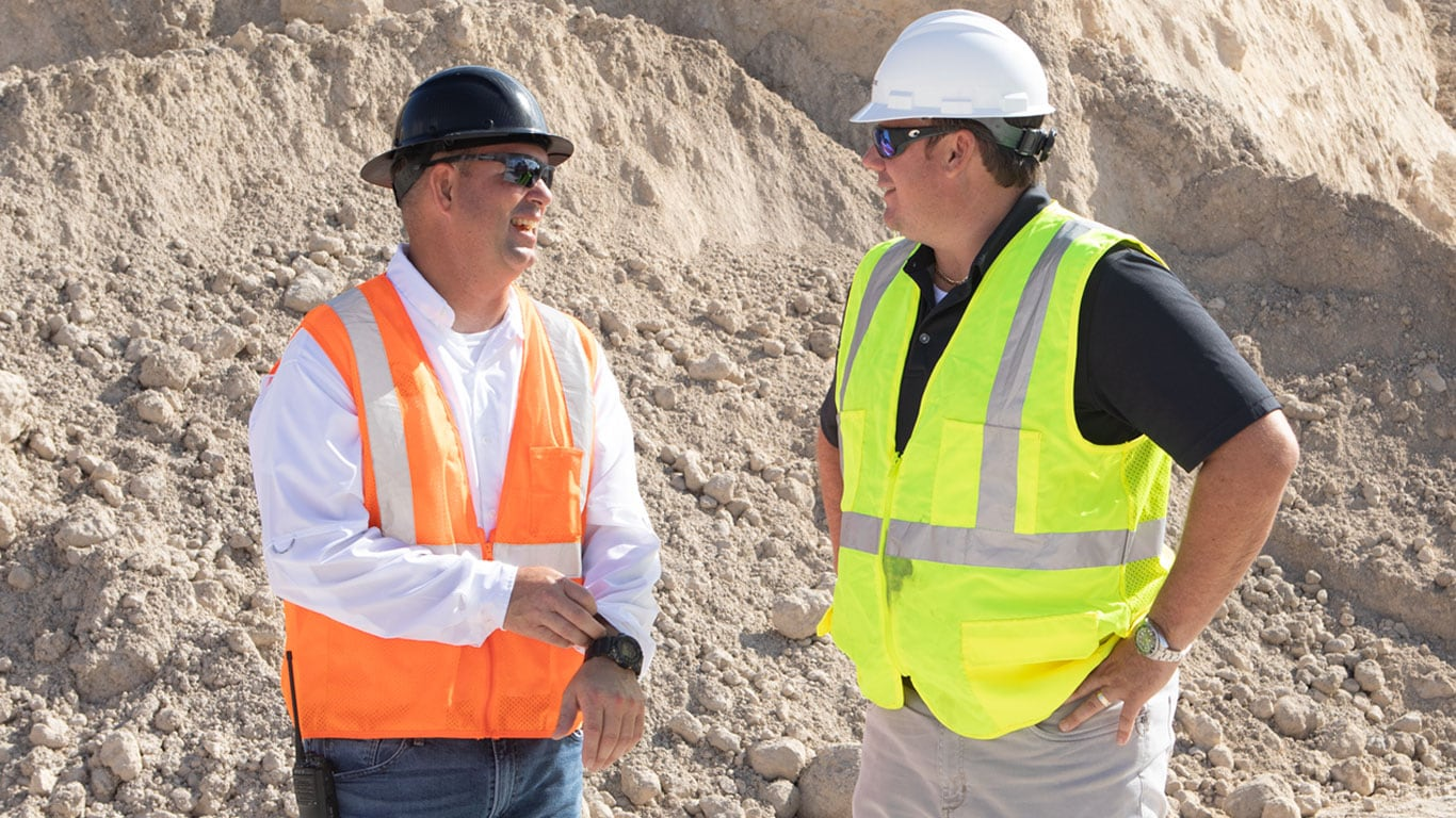 Dobbs Equipment salesman Richard Taylor spends hours on-site with Director of Sales Will Moore (left) and other Bedrock Resources personnel to better learn their complex business and help ma