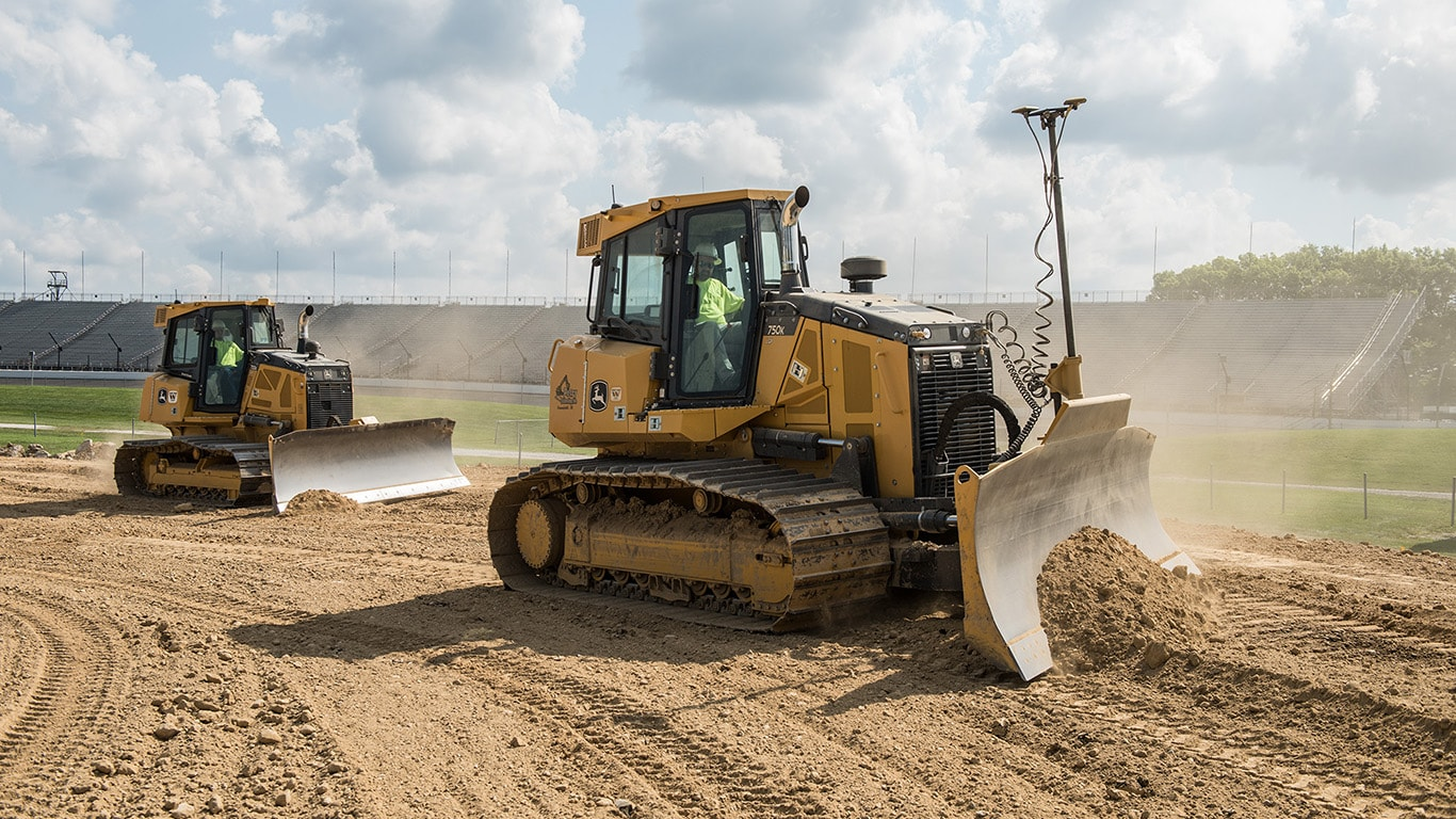 750K dozers work on a new track at the Indianapolis Speedway