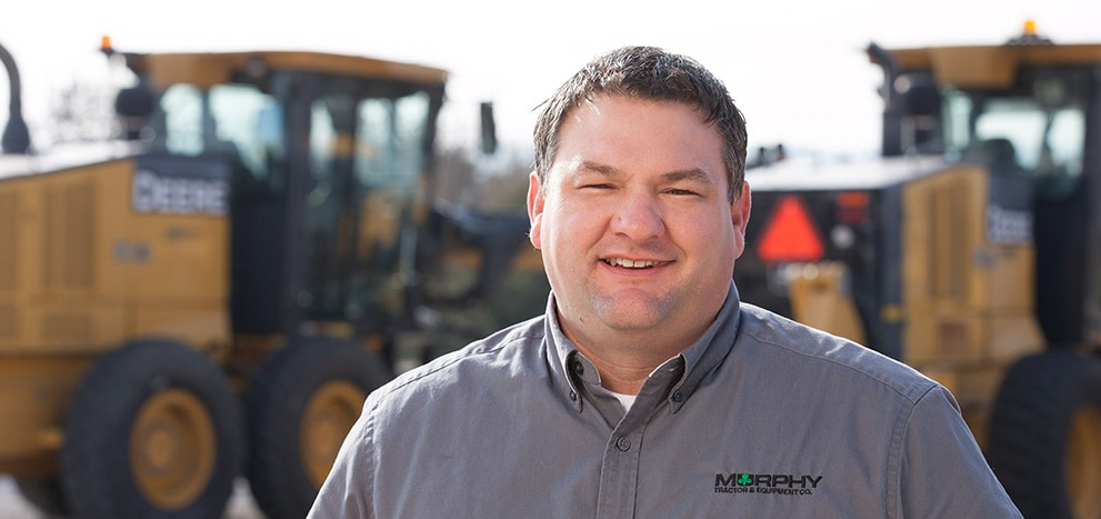 Doug Jacobsen with Murphy Tractor poses for a photo