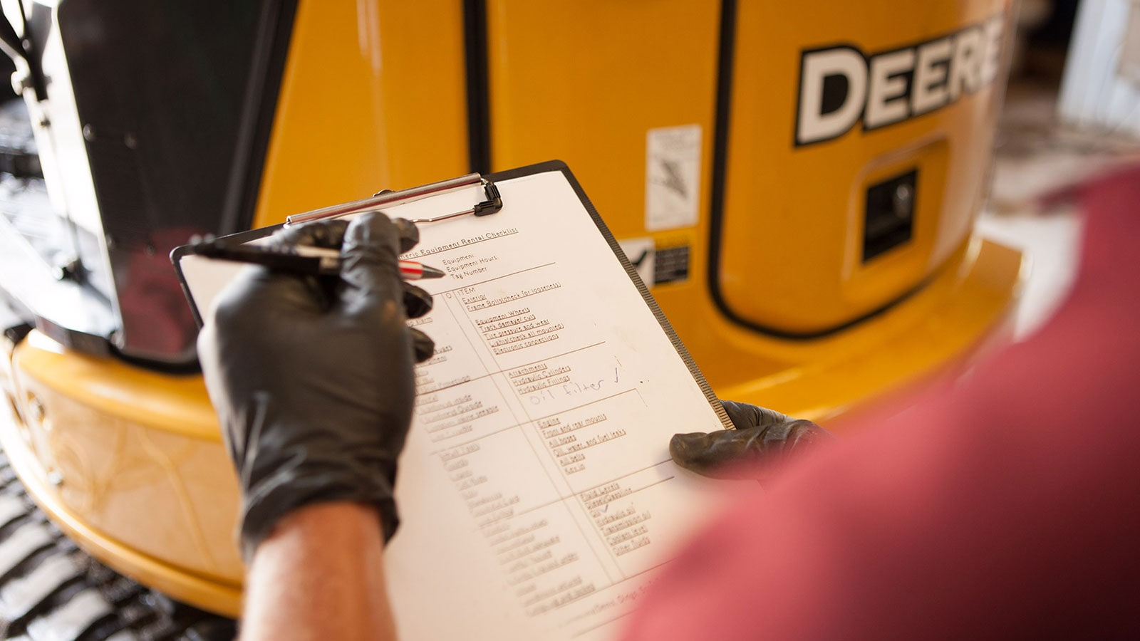A technician reviews a maintenance checklist
