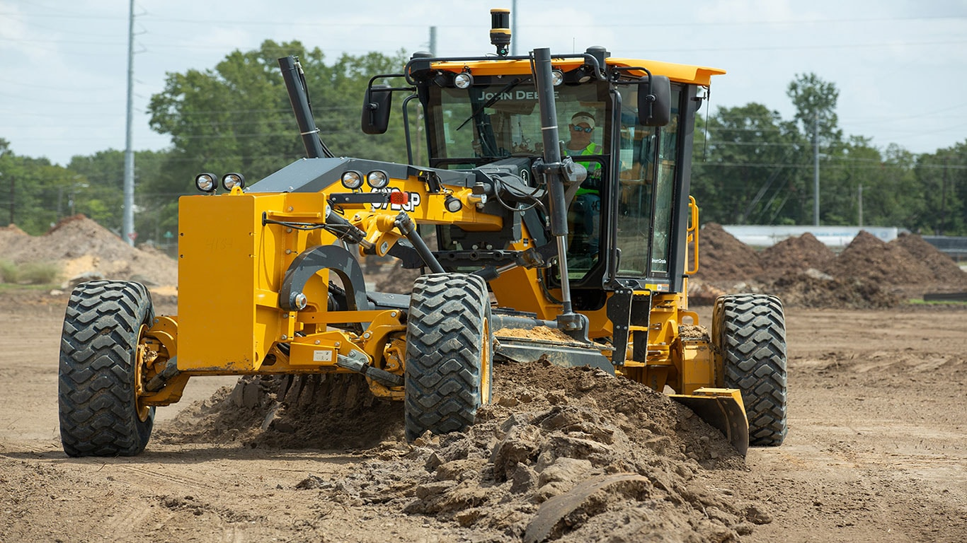 A motor grader working on a job site.