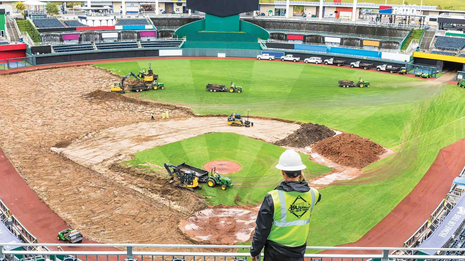 Steve Bush, owner of Bush Sports Turf, watches his all-Deere fleet in action in the Kansas City Royals' Kauffman Stadium.