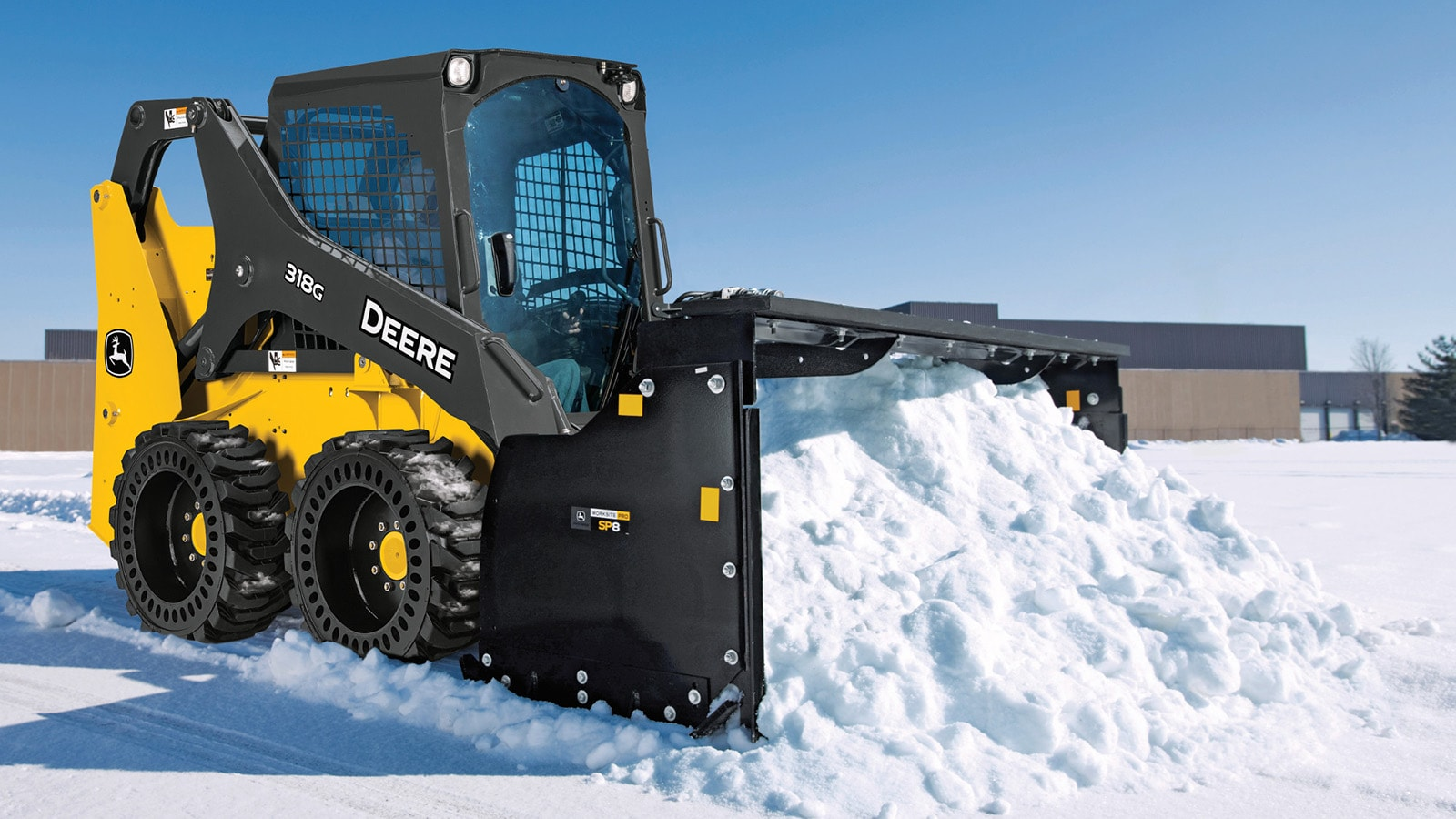 318G Skid Steer with snow pusher attachment removing snow