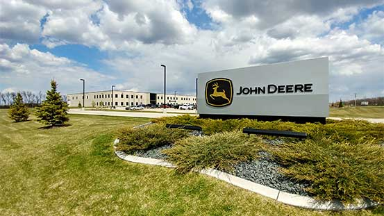 A John Deere sign in front of a building