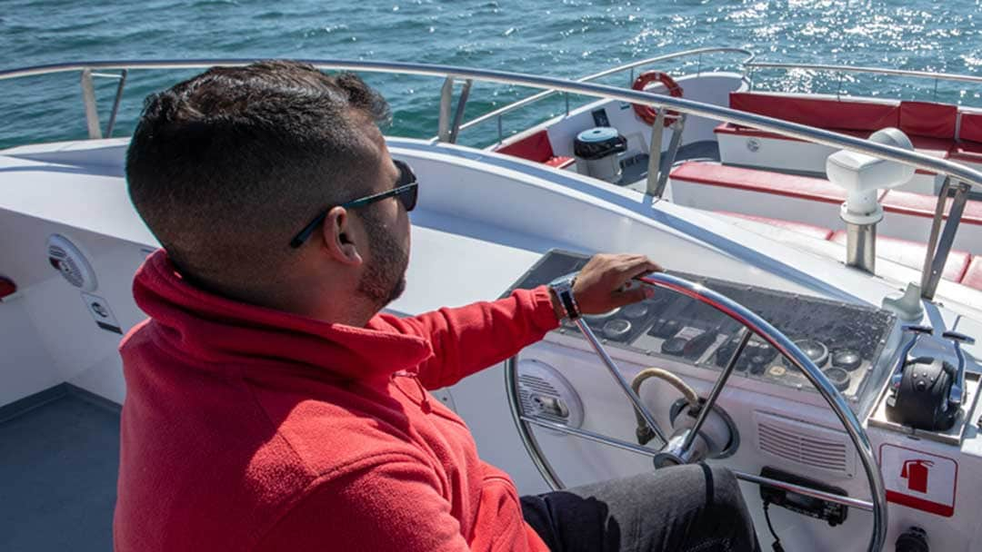João Bacalhau steers one of the AlgarExperience boats into the open sea.