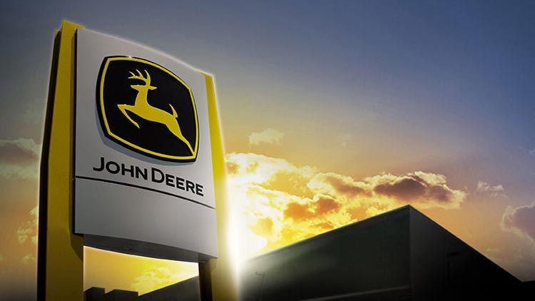 A John Deere dealer sign at sunset