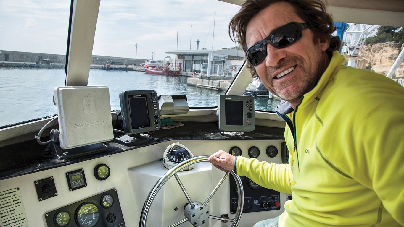 Miquel Rota, owner of M.Rota Diving, at the helm of ONAWA