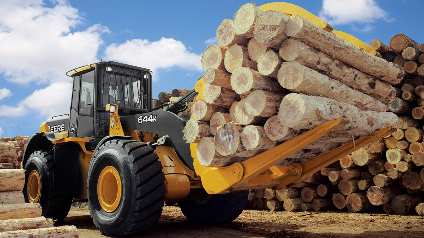 loader with log fork moving logs