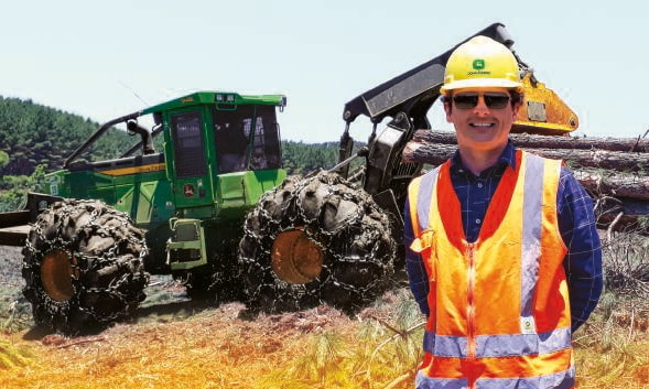 Crystian Fracasso stands in front of a skidder