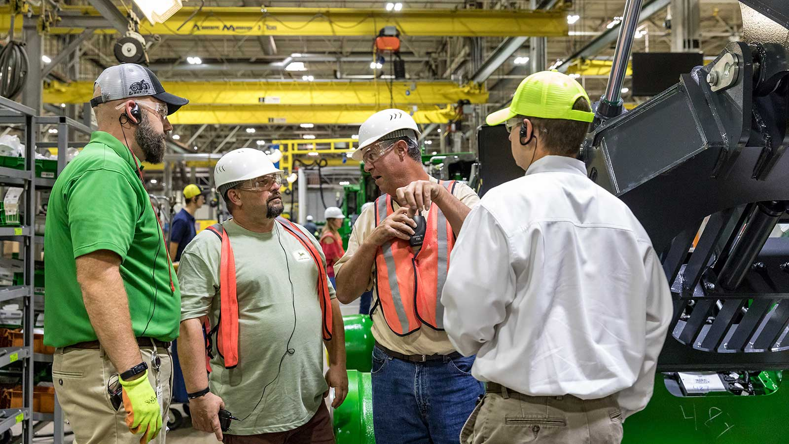 Roger Ferguson talks with Deere employees during his Gold Key factory tour