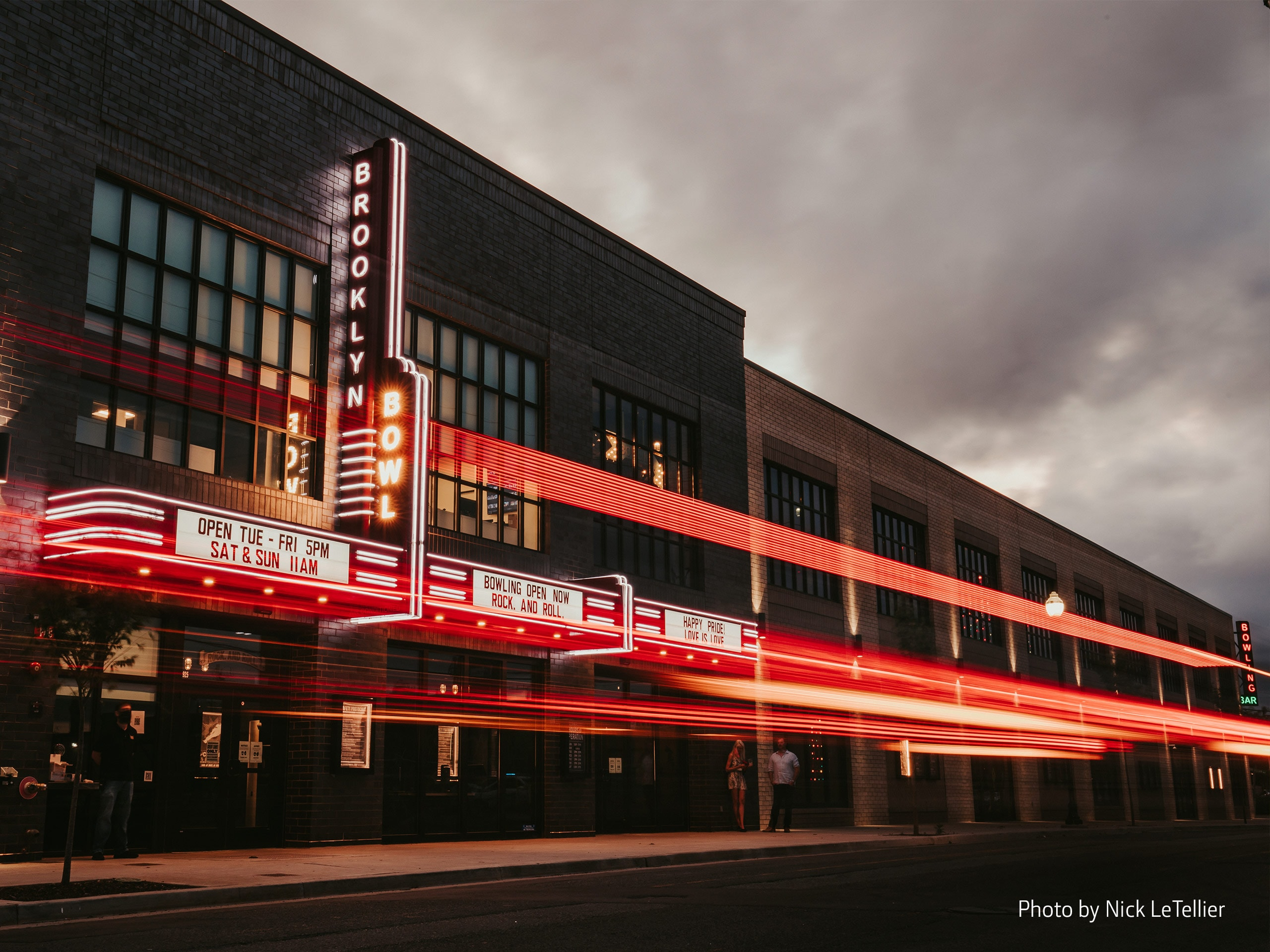 Exterior of the Brooklyn Bowl in Nashville with red neon lights