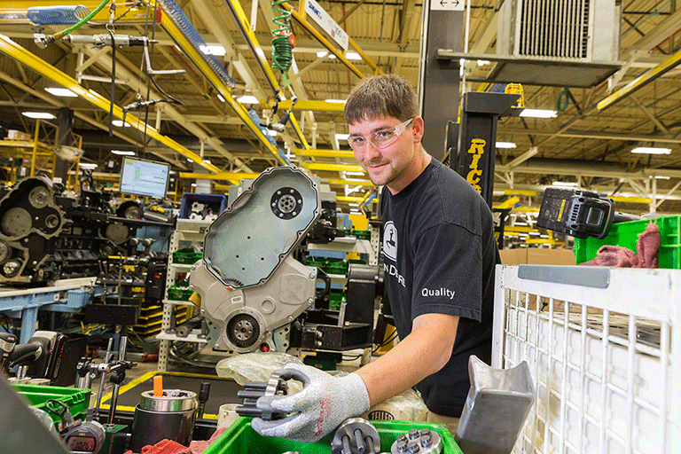 A man working in a John Deere factory.
