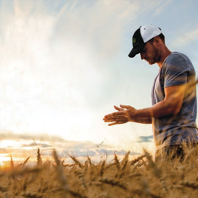 Man standing in wheat field