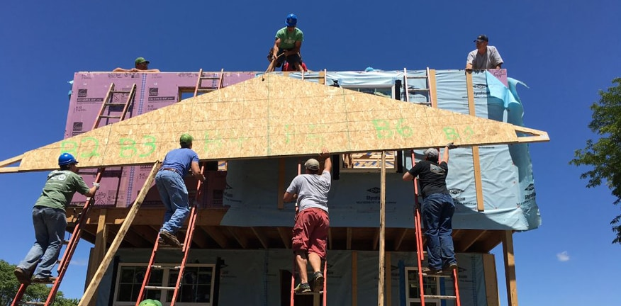 Photo of volunteers building a house