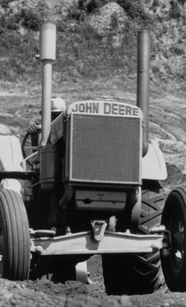 "Model ""DI"" tractor emerging from gravel pit, 1935"