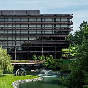 Exterior photo of the John Deere World Headquarters building overlooking the pond and fountains in Moline, Illinois, United States