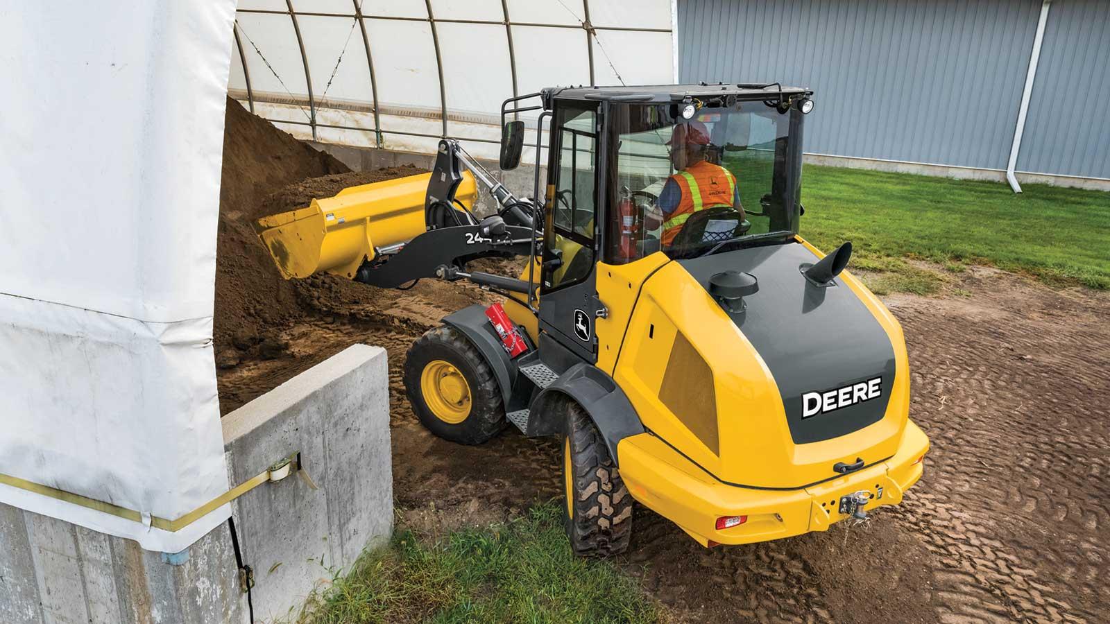 244L mini loader hauling dirt