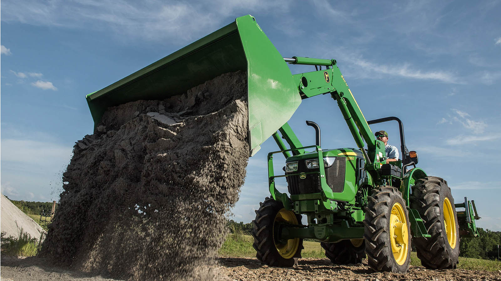 Loader visibility has been improved and controls have been repositioned to enhance operator comfort on the updated John Deere 5E Series Utility Tractors.
