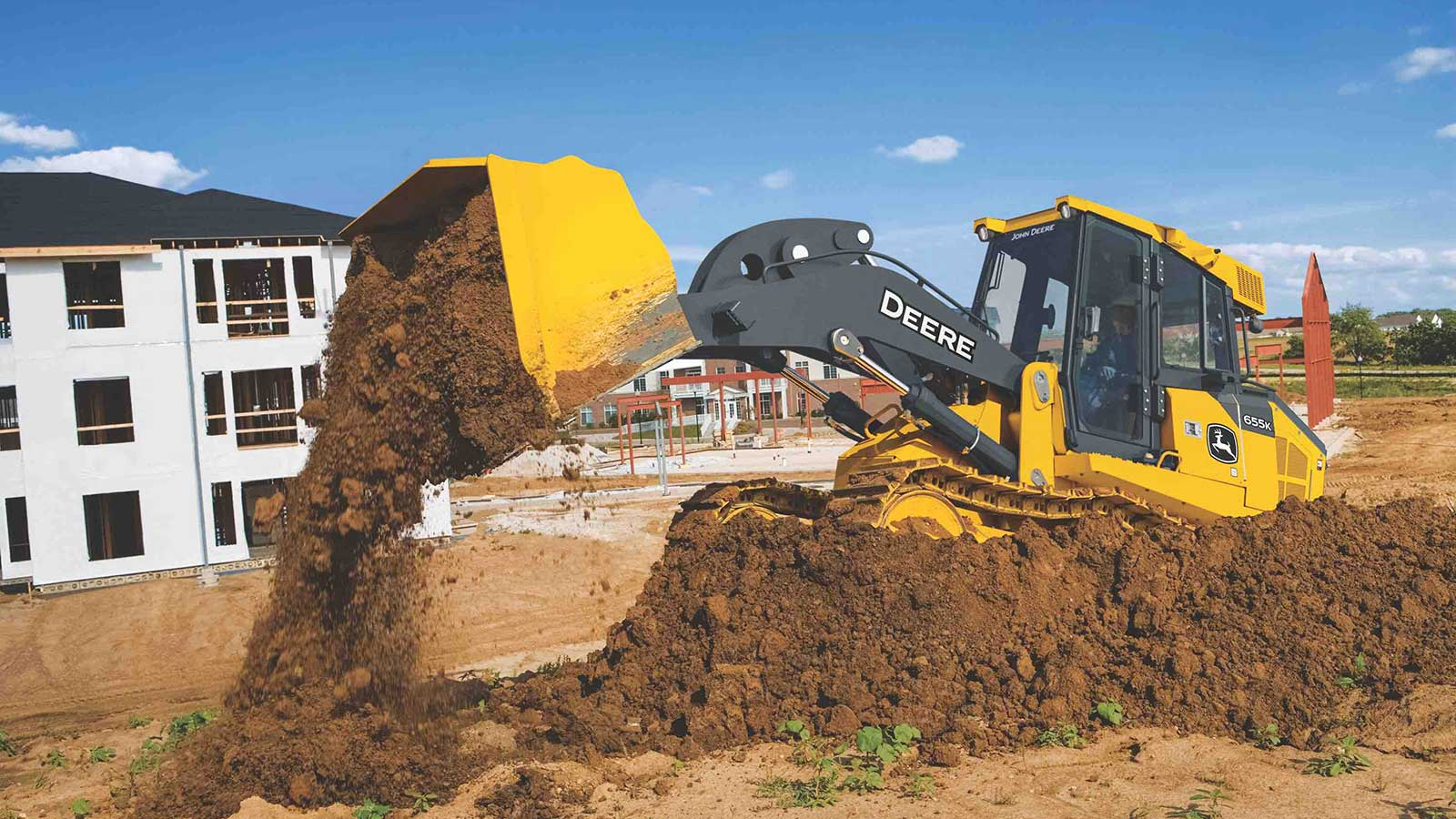 655K Crawler Loader dumping dirt out of its bucket