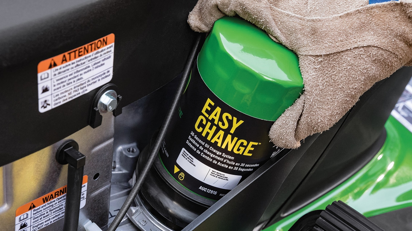Quickly change oil by twisting on a cartridge that contains both the oil and the filter