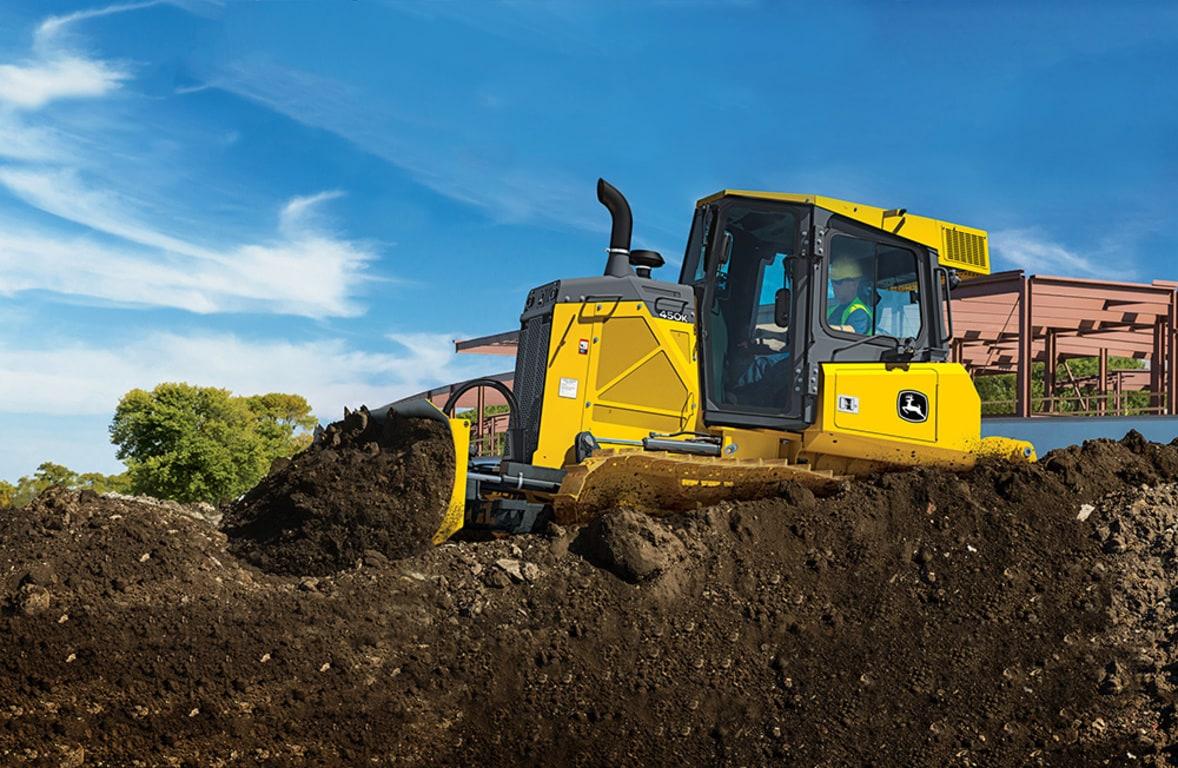 John Deere 450K Crawler Dozer Moves Bucket Of Dirt
