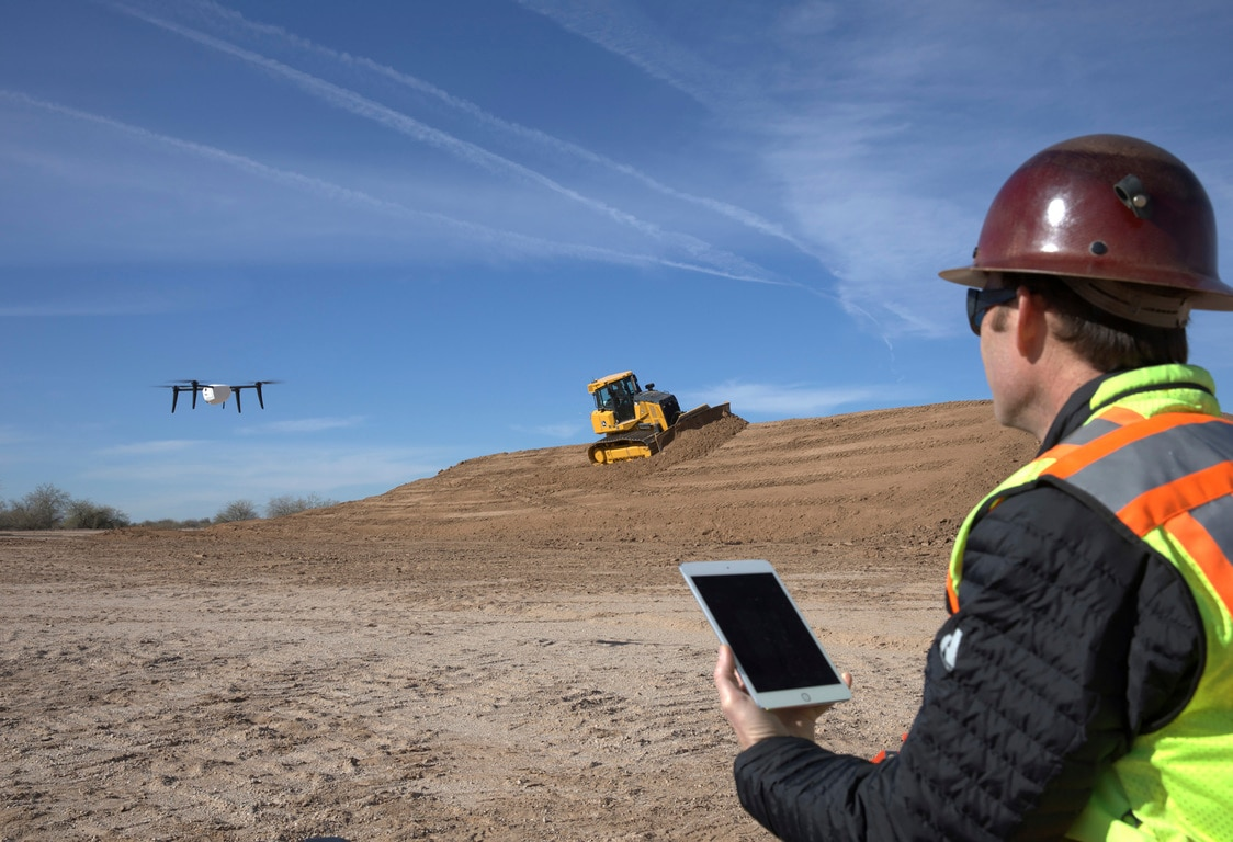 Man operating drone on worksite