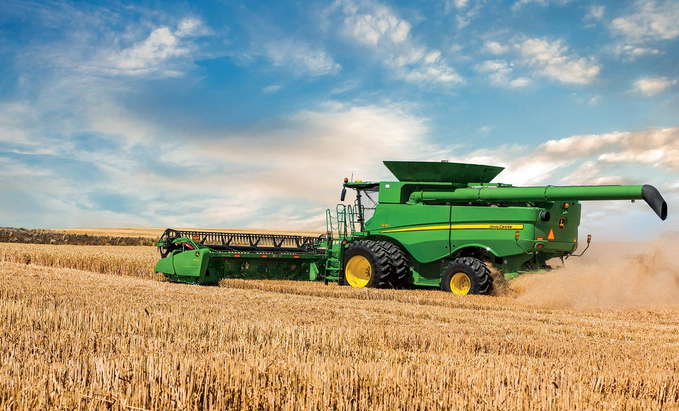 Image of a John Deere S-Series Combine harvesting a field