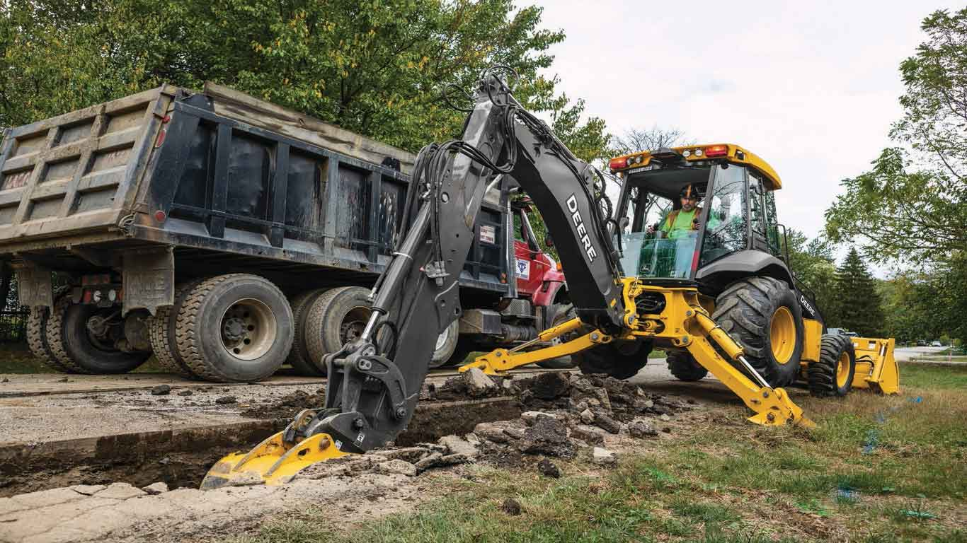 Large image of L-Series Backhoe digging on a jobsite