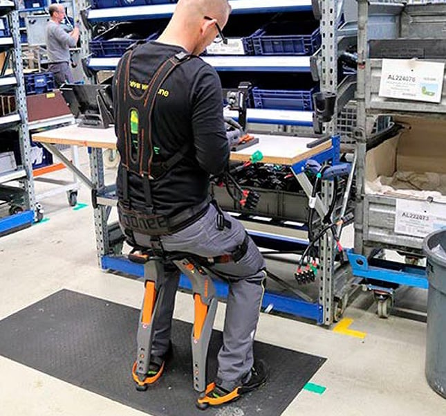 "Factory employee leaning on the ""chairless chair"" device that is attached to his body at the factory in Mannheim, Germany."