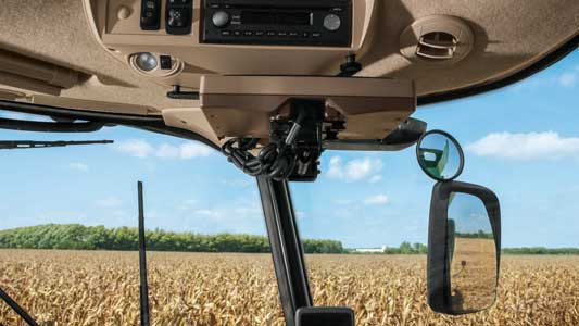View through a John Deere tractor cab